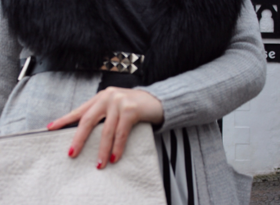 Studded-belt-faux-fur-leather-clutch