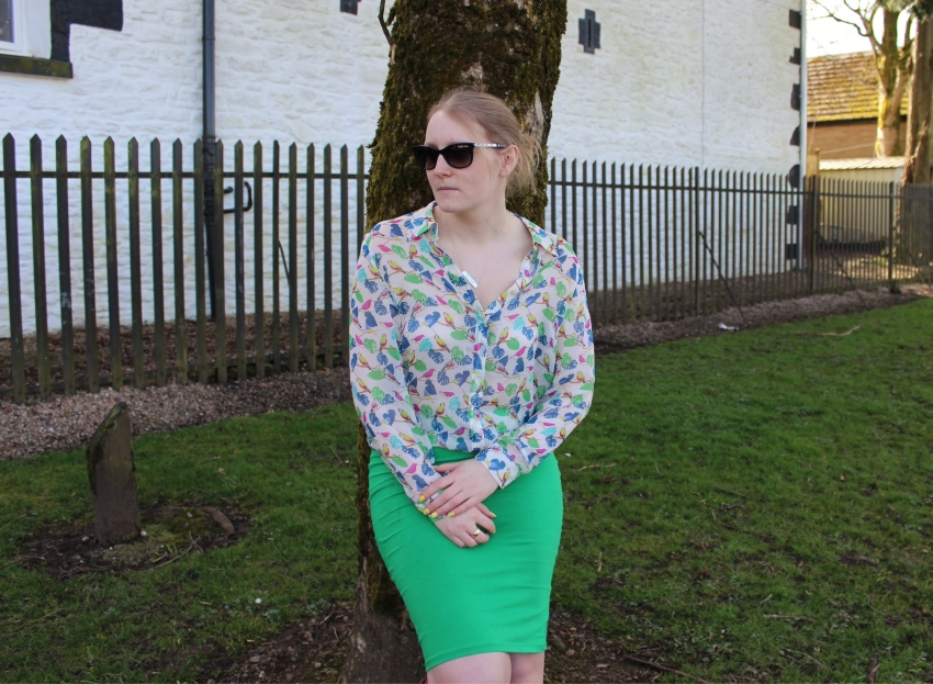 Green-pencil-skirt-sheer-patterned-blouse-street-style