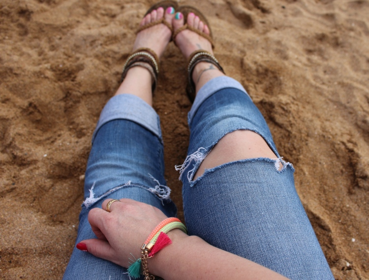 Striped-shirt-distressed-denim-beach-outfit
