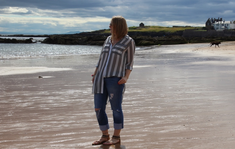 Striped-shirt-distressed-jeans-beach-outfit